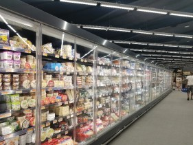 A store filled with lots of food Description generated with high confidence