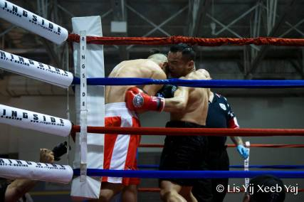 Duan Vue Lands a left hook to the body. Photo Credit: Lis Yij Xeeb Yab