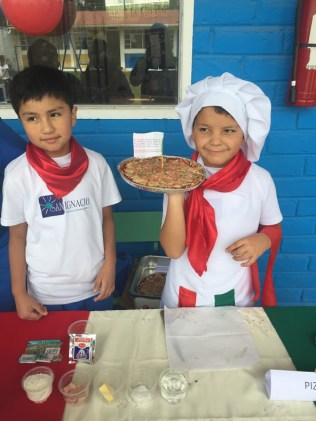 Showing off their pizza!