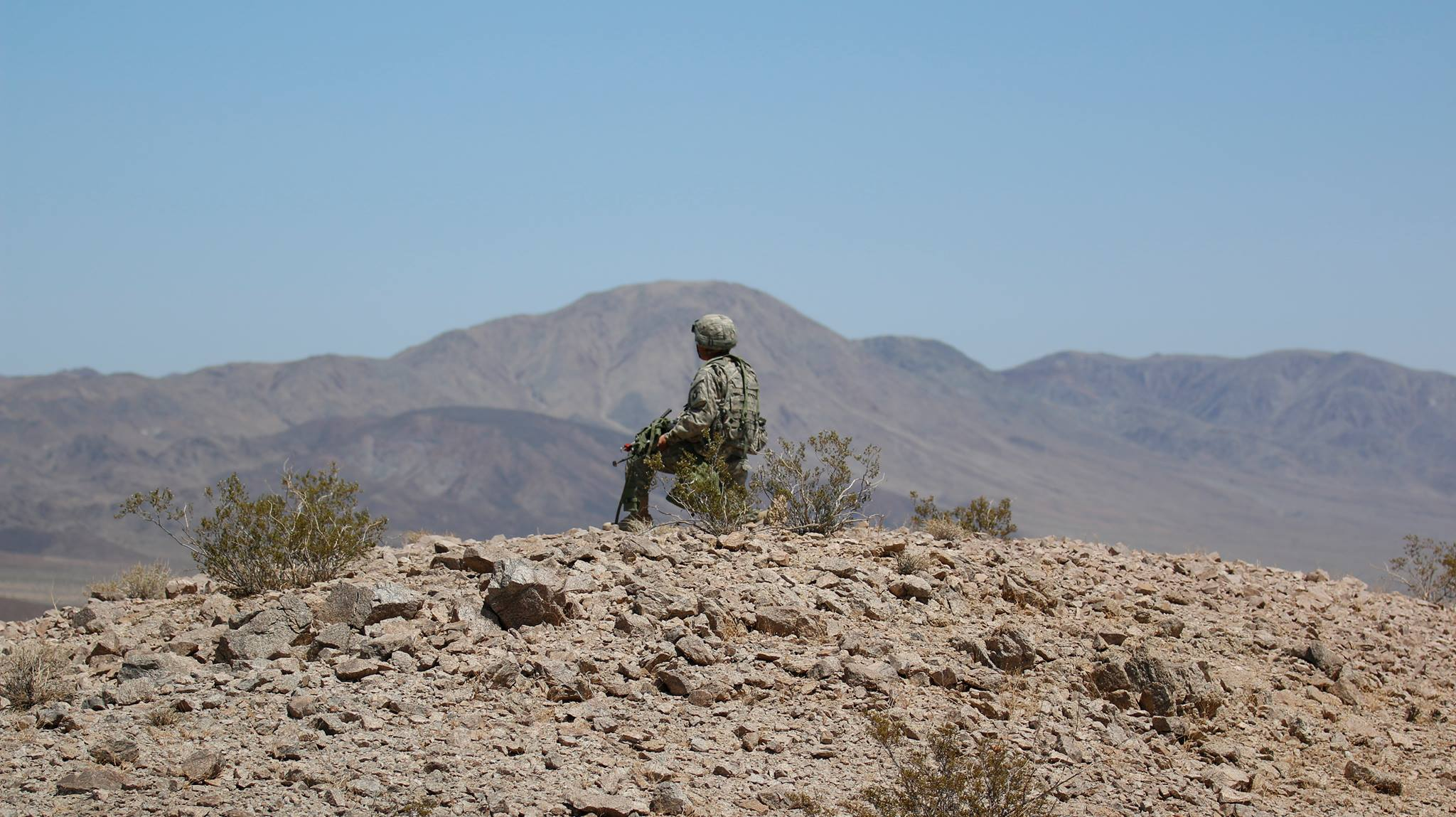 A Soldier guards a simulated downed aircraft site during a National Training Center rotation at Fort Irwin, California, May 16, 2018.