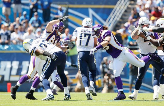 Photo of Brian Robison rushing Phillip Rivers