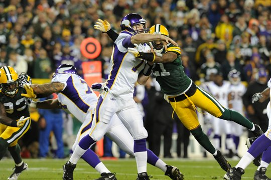 Photo of Christian Ponder Throwing A Pass Against The Packers At Lambeau Field