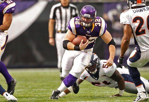 Photo of Toby Gerhart rushing against the Denver Broncos