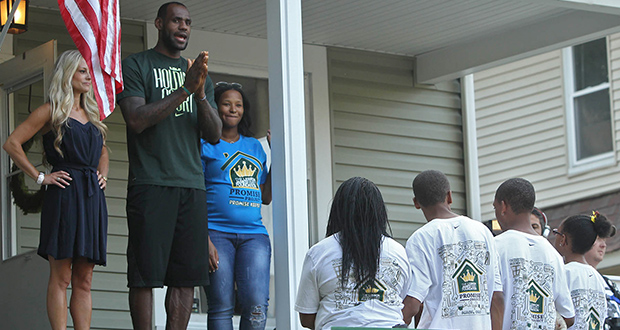 """Rehab Addict"" TV show host Nicole Curtis, left, appears in 2014 with Cleveland Cavalier LeBron James and his wife, Savannah, at a renovation project in Akron, Ohio. The Minnesota Court of Appeals has ruled that a judge was right to toss out a defamation lawsuit brought by Curtis against her former boyfriend Jason Jenny. (AP file photo: Akron Beacon Journal)"