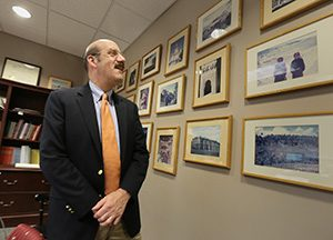 Gordon's office is replete with photographs from his travels taken by his wife, Anne. (Staff photo: Bill Klotz)