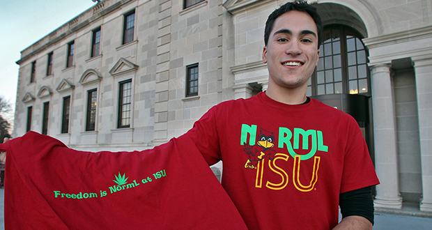 In this photo taken Nov. 15, 2012, Josh Montgomery, the former president of the Iowa State University chapter of the National Organization for the Reform of Marijuana Legislation, displays a T-shirt that shows the organization's logo on the front with an ISU mascot. (AP file photo)