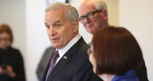 In this June 6 photo, Gov. Mark Dayon, left, stands with DFL state Reps. Duane Sauke and Tina Liebling, and fields questions about the recently ended legislative session at a meeting at Rochester City Hall in Rochester. (AP photo: Rochester Post-Bulletin)