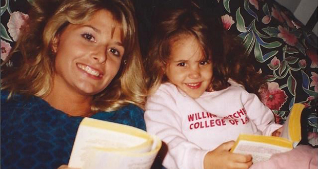 A family photo shows Carolyn Agin Schmidt with a very young daughter, Sammi, whose sweatshirt offered a hint of her future occupation. (Submitted photo)