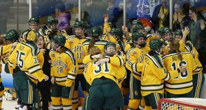 Clarkson University players celebrate their 2-1 overtime victory over Colgate University in the NCAA women's hockey Frozen Four championship game Sunday, March 18, in Minneapolis. (AP Photo: Stacy Bengs)
