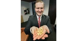 Ryan Osterholm, attorney at Pritzker Hageman, with a handful of pumpkin seeds. (File photo: Bill Klotz)