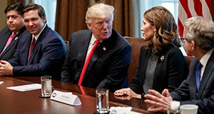 President Donald Trump speaks to Gov.-elect Kristi Noem, a South Dakota Republican, during a meeting with newly elected governors Dec. 13 in the Cabinet Room of the White House. From left, Gov.-elect J.B. Pritzker, D-Ill., Gov.-elect Ron DeSantis, R-Fla., Trump, Noem, and Gov.-elect Mike DeWine, R-Ohio. Minnesota's governor-elect, Tim Walz, declined to attend. (AP photo)