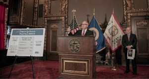 Gov. Tim Walz presents his revised budget on March 22 with MMB Commissioner Myron Frans at his side. (Staff photo: Kevin Featherly)