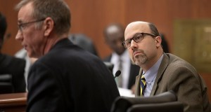 Rep. Dave Pinto, DFL-St. Paul (right), listens to DHS Deputy Commissioner Chuck Johnson testify before the House Judiciary committee on March 20. Pinto's House File 2319 creates a new felony crime for kickbacks and bribes associated with the state's troubled Child Care Assistance Program and other government-funded human services. (Staff photo: Kevin Featherly)