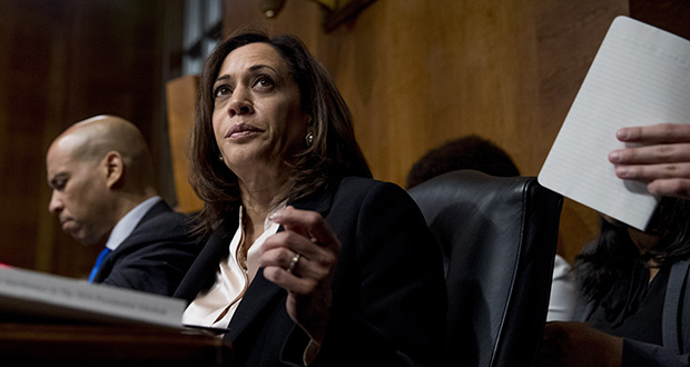 In a Wednesday, May 1, 2019 file photo, Democratic presidential candidates Sen. Cory Booker, D-N.J., left, and Sen. Kamala Harris, D-Calif., center, listen as Attorney General William Barr testifies during a Senate Judiciary Committee hearing on Capitol Hill in Washington, on the Mueller Report.  (AP photo)