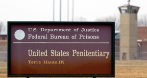 A guard tower flanks the sign at the entrance to the U.S. Penitentiary in Terre Haute, Indiana, the site of the last federal execution. The Justice Department says it will carry out executions of federal death row inmates for the first time since 2003. (AP file photo)