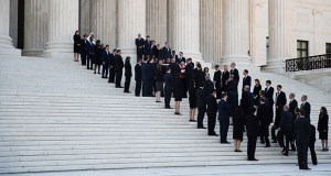 Former law clerks of the late Justice John Paul Stevens line the steps of the U.S. Supreme Court building in Washington on Monday as his casket is carried inside. (AP photo: Manuel Balce Ceneta)