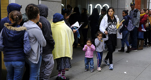 In this Jan. 31, photo, hundreds of people stand in a line snaking around the block outside a U.S. immigration office with numerous courtrooms in San Francisco. (AP file photo)