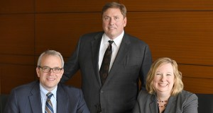 Briggs & Morgan will change its name but keep its legacy and its leadership with Steven Ryan, left, becoming partner in charge of the Minneapolis office and Ann Rainhart becoming chief strategy officer. Robert Hicks, center, is Taft's chair and managing partner. (Submitted photo: Briggs & Morgan)