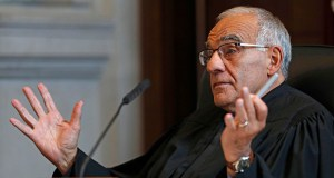 Justice Joseph M. Jabar asks a question during a hearing in the Maine Supreme Judicial Court on whether ranked-choice voting can be used in Maine's June 12th primary, April 12, 2018, in Portland, Maine. (AP Photo/Robert F. Bukaty)