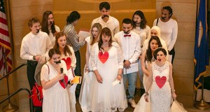 At the Chain-In to End Child Marriage event on Feb. 13, Dawn Tyree (center, in wedding dress) sings in the Capitol Rotunda with her fellow proponents of Senate File 1393, a bill to prohibit minors under the age of 18 from marrying. (Staff photo: Kevin Featherly)