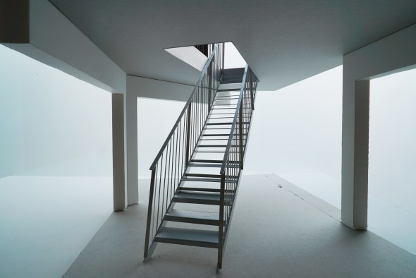 The galvanised steel stairs up to the kitchen.