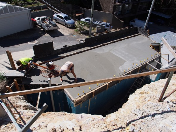 The concrete garage roof slab is poured.