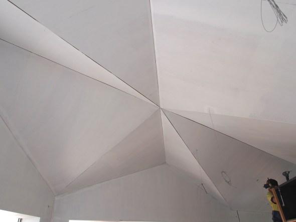 Ceiling primed, gaps prior to filling.