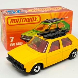 Matchbox Superfast No.7c Volkswagen Golf - yellow body, clear windows, red interior, metallic dark graphite grey base - Near Mint in near mint type K box.