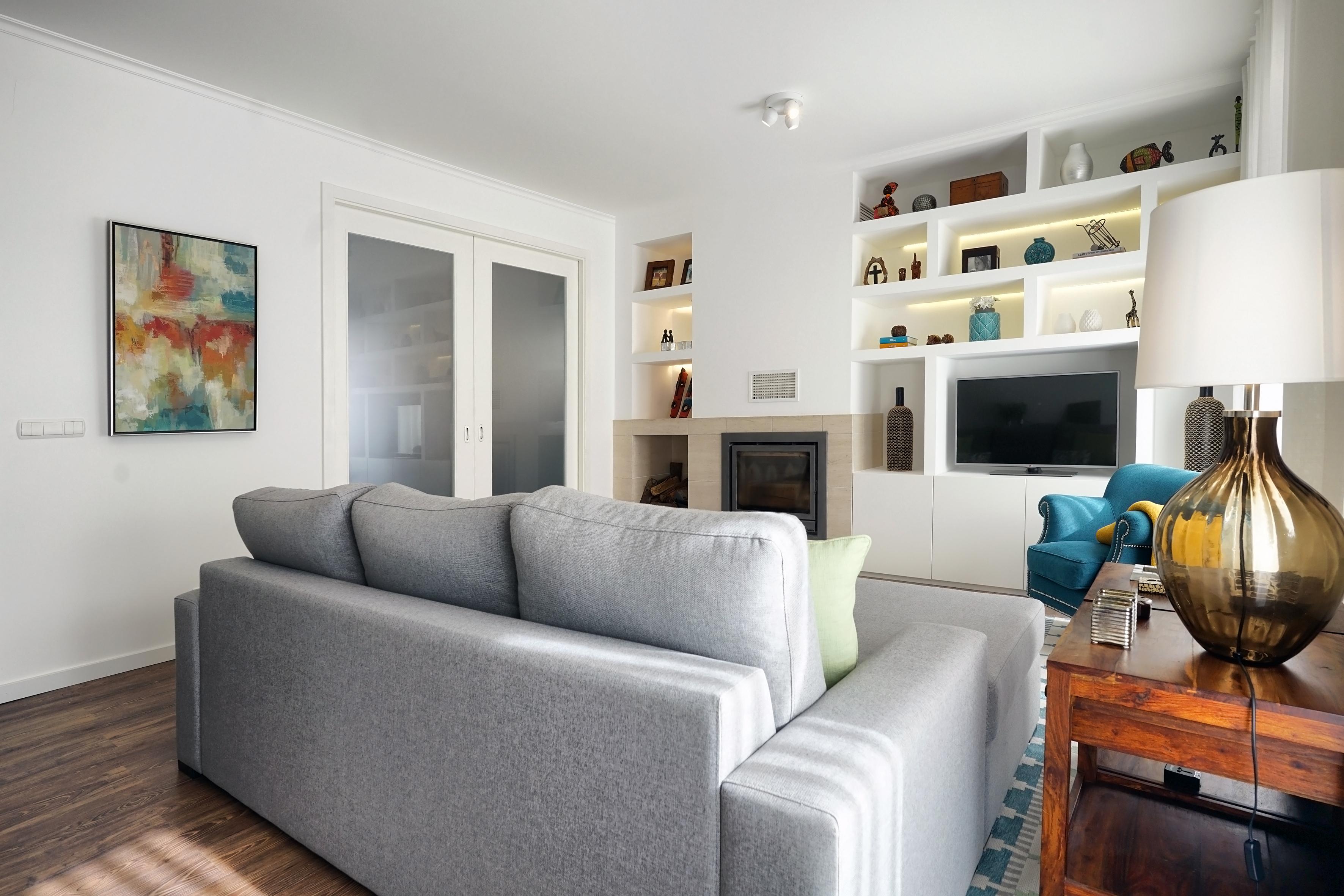 Sofá no centro da sala de estar Mint Design