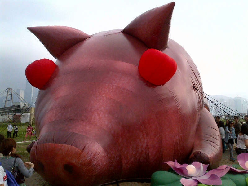 Pumped up inflatable pig in Kowloon Park, Hong Kong