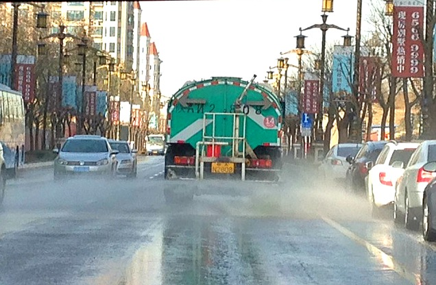 "China: These water trucks are everywhere in Xi'an. It's so dusty they are constantly washing the roads cruising the streets to the tune ""It' a small world..."" #LivinginChina"