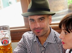 Pep Guardiola toasts Bayern Munich's success at the Oktoberfest, accompanied by his wife.