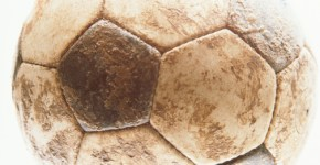 Soccer ball covered in mud, close-up