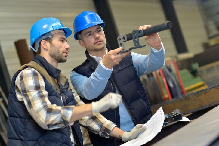 36001433 - engineer with mechanical worker checking on production