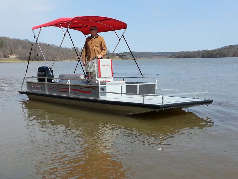 silver flat bottom boat with red cover