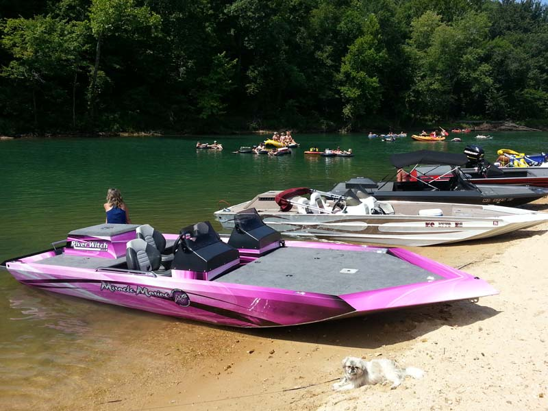 boats lined up on a gravel bar