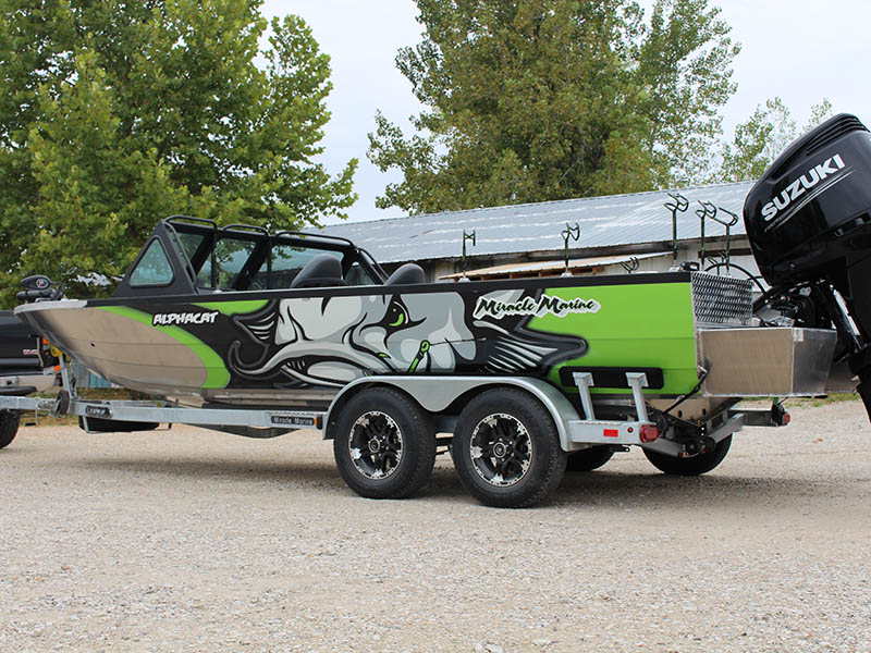green boat on trailer