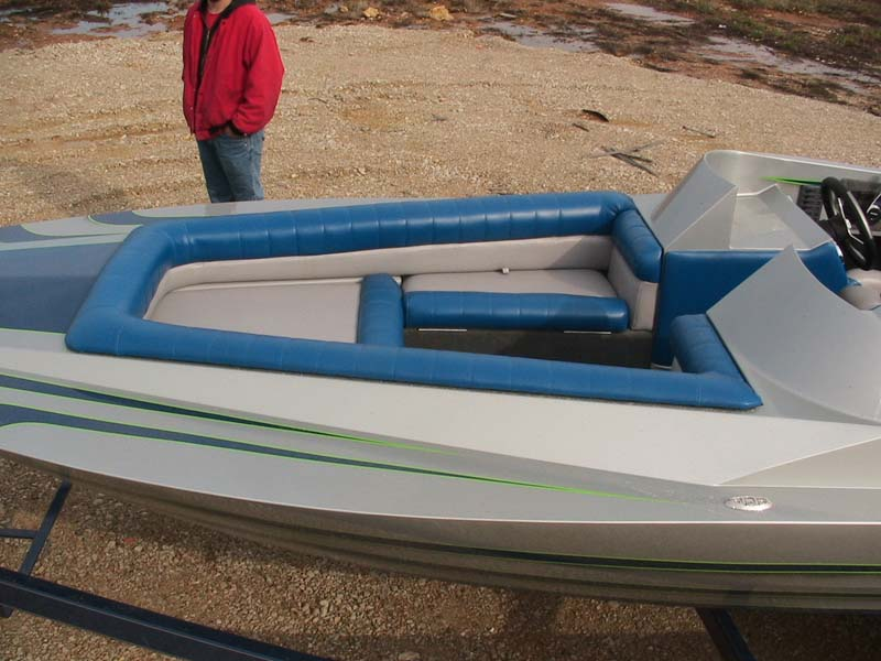 blue and gray boat front view