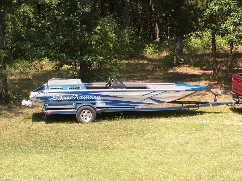 shoal runner blue and gray boat side view