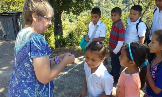 Betty handing out bracelets