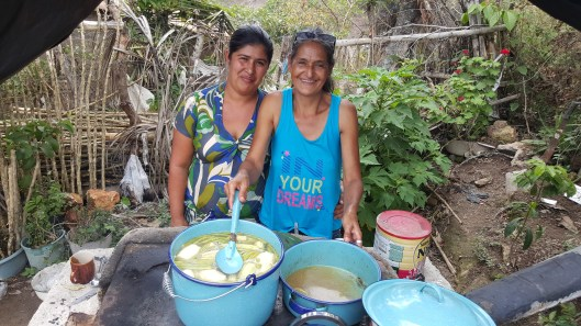 Family preparing soup