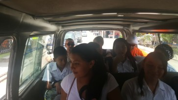 Francisco praying salvation prayer from the Good News tract in a van.