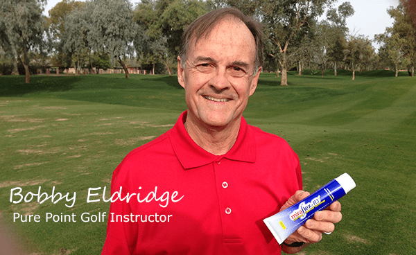 Bobby Eldridge Pure Point Golf Instructor holding MiraFlex Pain Relief Cream