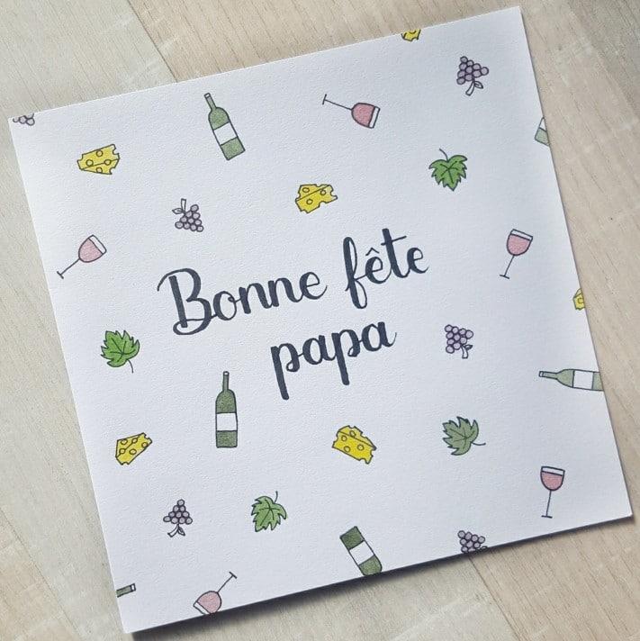 Carte calligraphiée pour la fête des pères avec une décoration personnalisée sur le thème du vin
