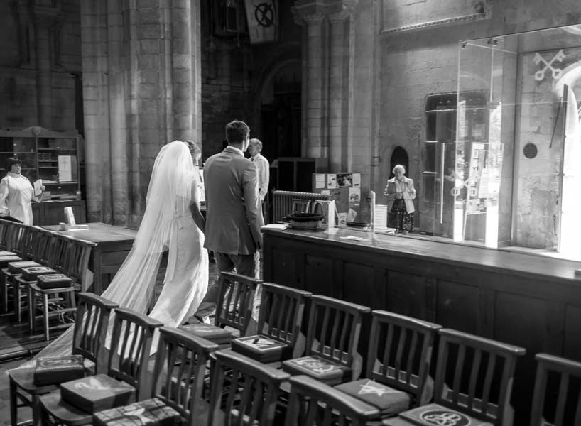 documentary lifestyle photography familyhappy newlywed couple is leaving the church. good bye and enjoy every minute of your future life. wedding day in London, South East UK