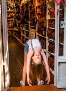 dancing gymnastics photography in the shop window of Camden Town London family photographer