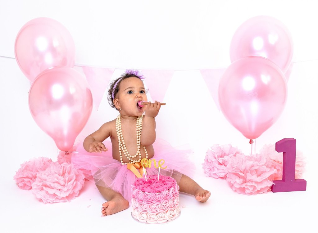 Cake Smash Photography, Girl Daughter Baby having Birthday Celebration Cake Smash 1st Birthday in London Enfield Barnet Palmers Green