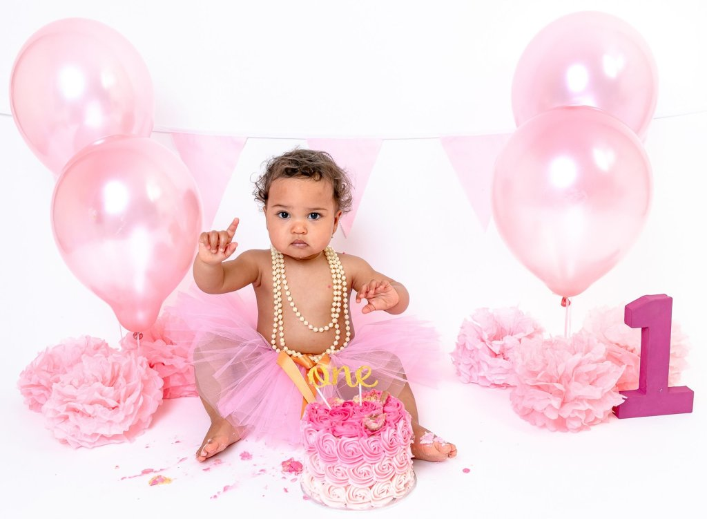 Cake Smash Photography, Girl Daughter Baby having Birthday Celebration Cake Smash 1st Birthday in London Winchmore Hill