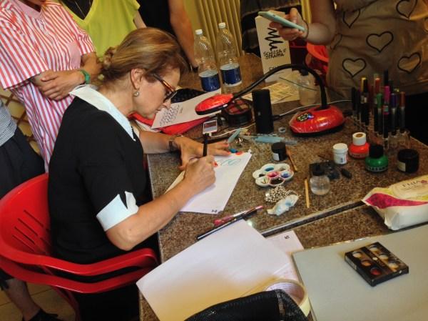Barbara Calzolari demonstrates the brush pen, MODO infoshop, Bologna, June 4–5, 2016 (photo: Miriam Jones).