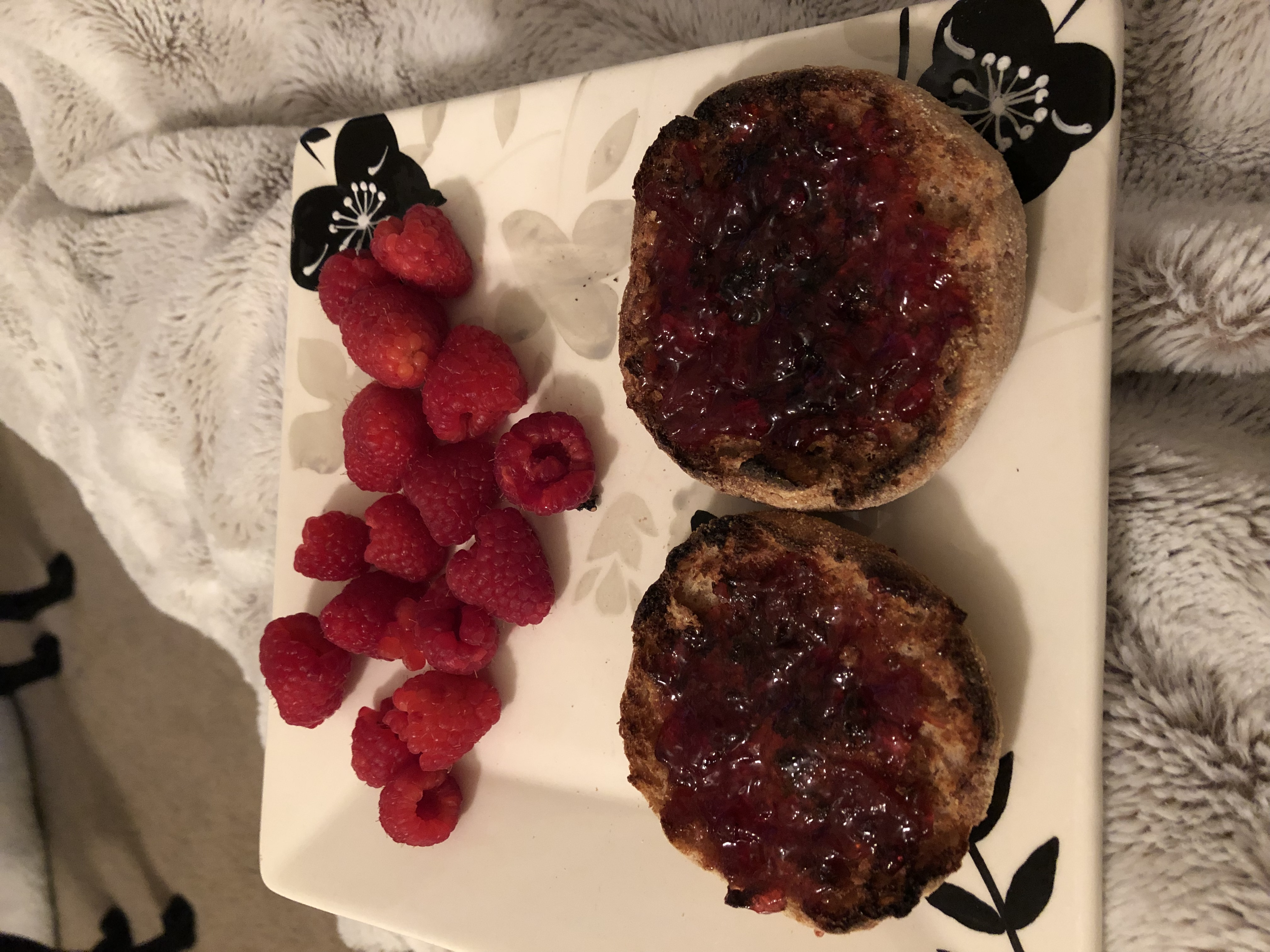 English muffin with jam and raspberries